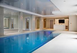 Beautiful deck level pool with stretched ceiling