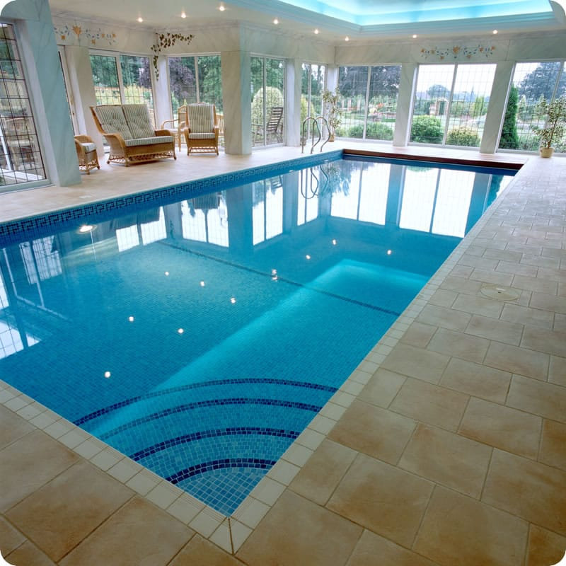 Indoor tiled pool with curved step entrance